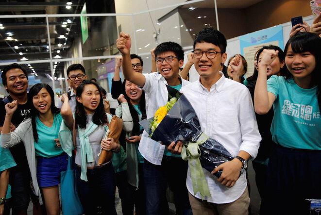 Les chefs de file étudiants Joshua Wong et Nathan Law, ici en septembre 2016, ont par la suite été condamnés à des peines de prison, finalement cassées par la Haute Cour. © Tyrone Siu/Reuters