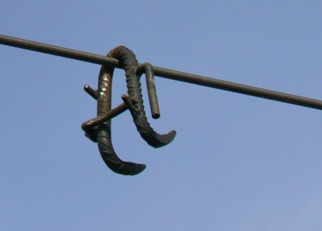 L'arme du crime : un crochet en fer à béton © DR
