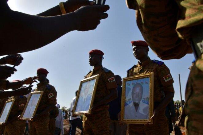 Cérémonie funéraire à Ouagadougou, le 7 mars 2018, après les attaques du 2 mars. © Reuters