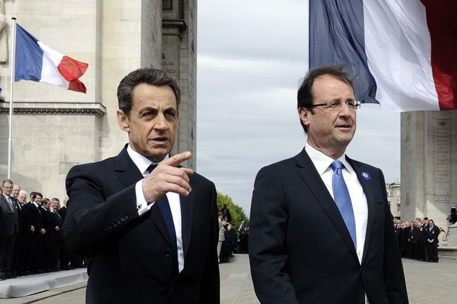 Nicolas Sarkozy with then-president François Hollande at a ceremony marking V-E Day on May 8th 2013. © Reuters