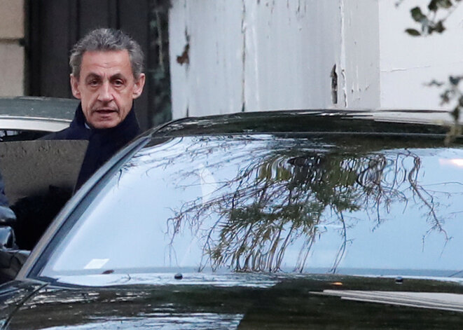 Nicolas Sarkozy leaving his Paris home Wednesday morning for a second day of questioning. © Reuters