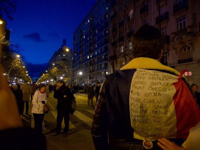 A march in homage to Mireille Knoll, an 85-year-old Jewish woman and Holocaust survivor who was murdered in an anti-Semitic attack in Paris in March 2018. A man bears on his back a list of names of Jews murdered in France in recent years, which ends with the message: 'Murdered because Jewish'. © LF