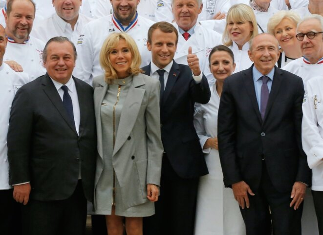 Events organiser Olivier Ginon, left, with Brigitte Macron, President Emmanuel Macron and interior minister Gérard Collomb at the Elysée in September 2017. © Reuters