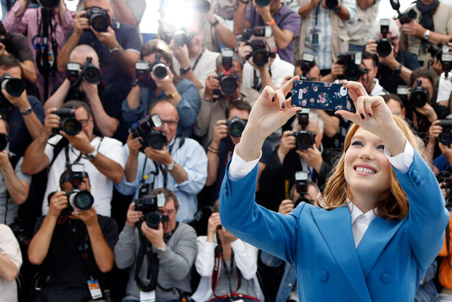 Authorised: French actress Léa Seydoux takes a selfie at the 2014 Cannes Film Festival. © Reuters