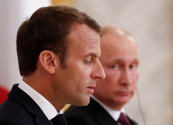 Emmanuel Macron et Vladimir Poutine, le 24 mai, à Saint-Pétersbourg. © Reuters