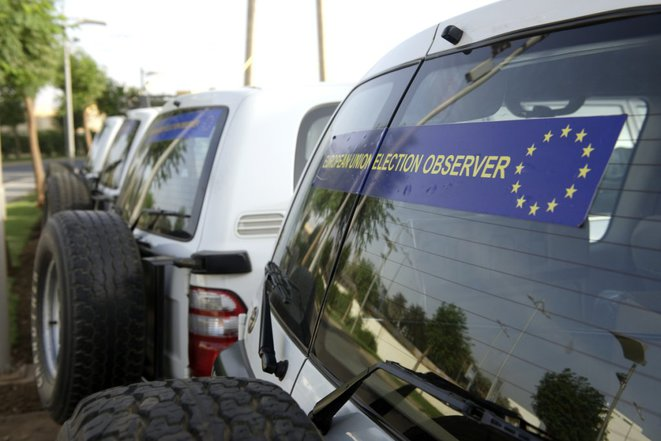 Vehicles from a European Union election monitoring team mission. © EU