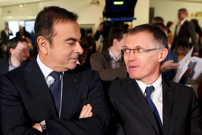 Carlos Ghosn, left, the CEO of Renault, and Carlos Tavares, chairman of the board at PSA Peugeot Citroën. © Reuters