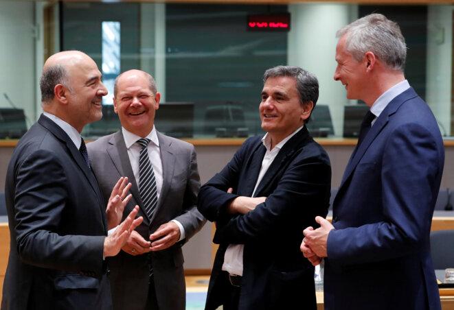Pierre Moscovici, commissaire européen au budget, Olaf Scholz, ministre allemand des finances, Euclid Tsakalotos, ministre grec des finances, Bruno Le Maire, ministre français des finances lors d'une réunion de l'Eurogroupe fin mai 2018. © Reuters