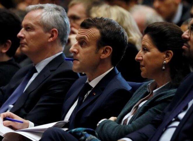 Bruno Le Maire, Emmanuel Macron et Agnès Buzyn, le 29 mars. © Reuters