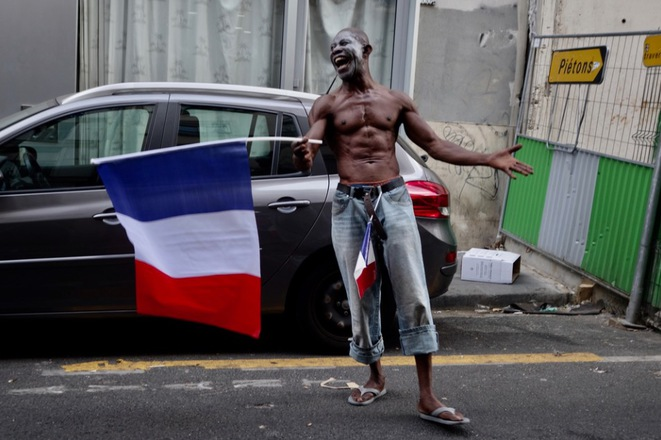 A man celebrates France's victory in the World Cup on Sunday in the Goutte d'Or neighbourhood of Paris. © Rachida El Azzouzi