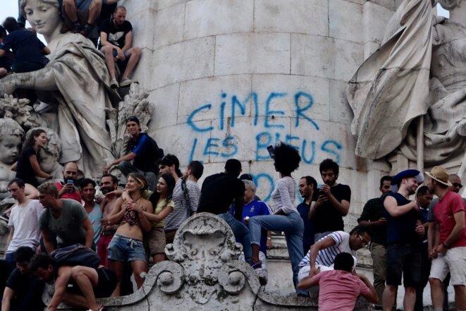 "Jubilant crowds invest the Place de la République in central Paris on Sunday evening. The word ""Cimer"" is French slang, an inversed ""Merci"", meaning ""Thanks"" to Les Bleus, the national team. © Rachida El Azzouzi"
