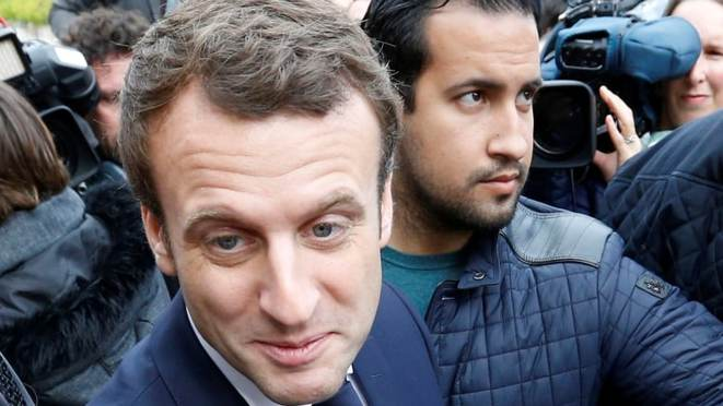 Emmanuel Macron (left) with his now disgraced security aide, Alexandre Benalla, during election campaigning in May 2017. © Régis Duvignau/Reuters