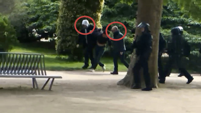 Alexandre Benalla (circled, with white hood) and Vincent Crase (circled right) during the arrest of a man in the Jardin des plantes on May 1st.
