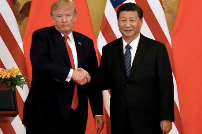 Donald Trump et Xi Jinping en mars 2018. © Reuters