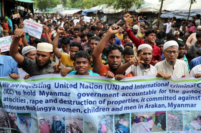 Displaced Rohingya demonstrating in a refugee camp in Bangladesh on August 25th. © Reuters