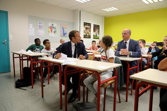 Jean-Michel Blanquer et Emmanuel Macron dans une école pour la rentrée scolaire. © Reuters