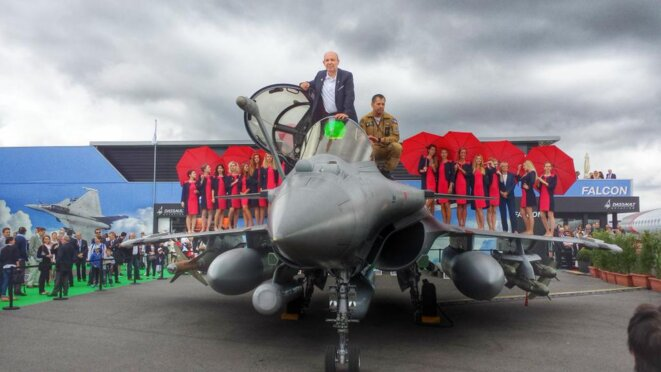 Éric Trappier, CEO of Dassault Aviation, standing on a Rafale jet fighter at the Le Bourget airshow near Paris in 2015. © Dassault