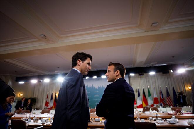 Justin Trudeau et Emmanuel Macron le 9 juin 2018 au G-7 de Charlevoix au Québec © Reuters.