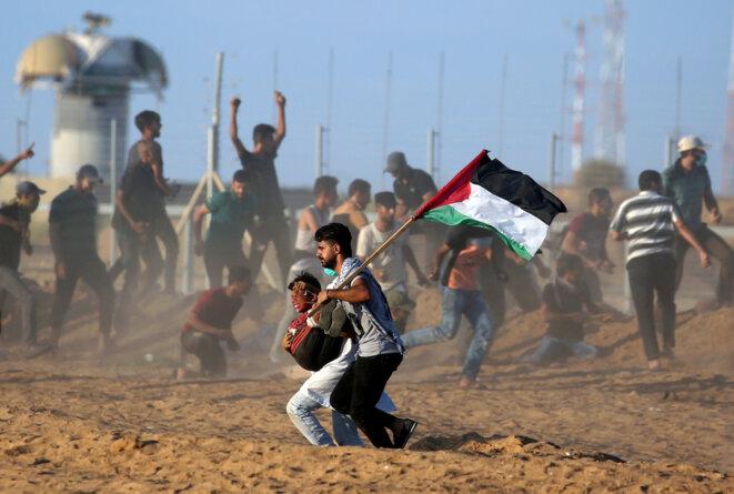 Manifestation le long du mur de séparation entre Gaza et Israël le 21 septembre 2018. © Reuters
