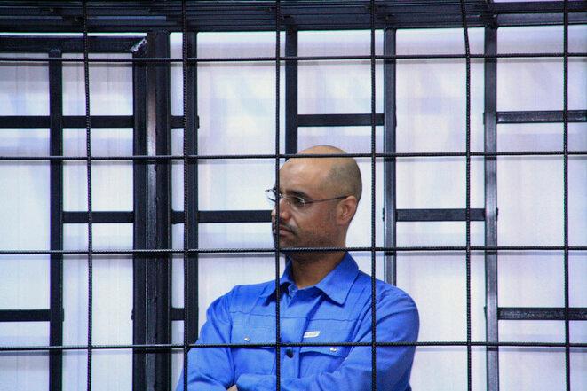 Saïf al-Islam Gaddafi appearing before a court in Zintan, Libya, on May 15th 2014. © Reuters