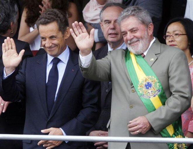 Le 7 septembre 2009, les deux présidents à la tribune officielle lors des cérémonies de la fête nationale de l'indépendance. © Reuters