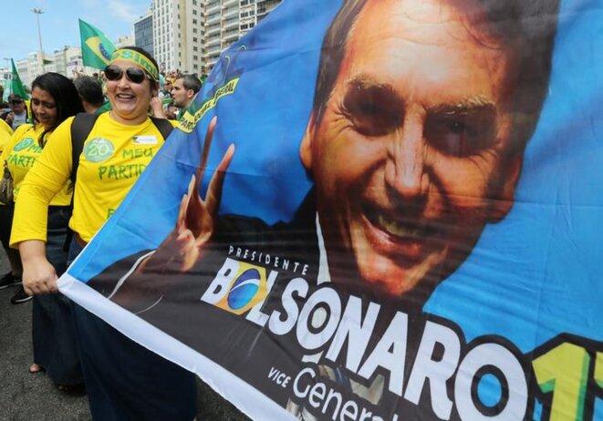 Des supporters de Bolsonaro, le 21 octobre, à Rio de Janeiro. © Reuters