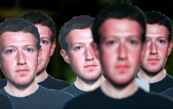 Effigies de Mark Zuckerberg, brandies lors d'une manifestation à Bruxelles à l'occasion de sa venue au Parlement européen, en mai 2018. © Reuters