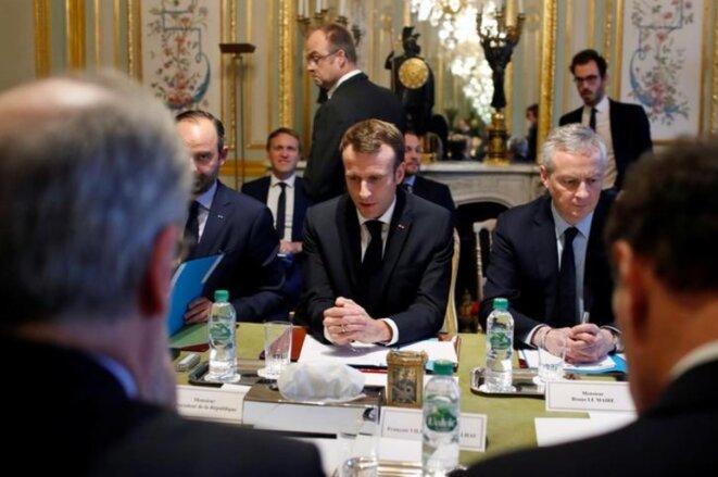 Édouard Philippe, Emmanuel Macron et Bruno Le Maire à l'Élysée, le 11 décembre. © Reuters