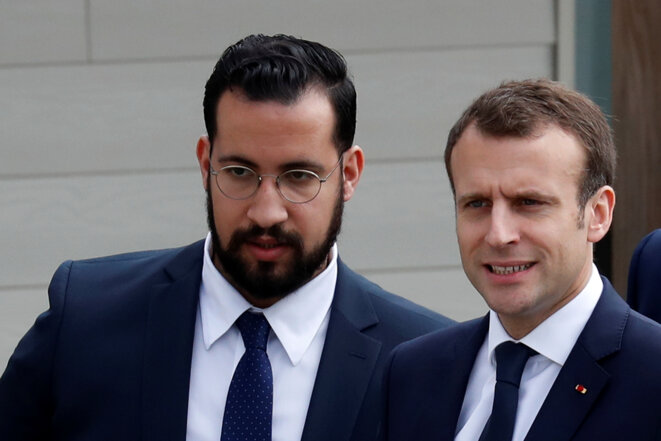 Alexandre Benalla and President Emmanuel Macron during a visit to Normandy April 12th 2018. © Reuters
