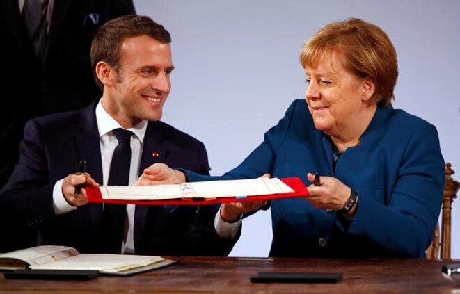 Emmanuel Macron et Angela Merkel à Aix-la-Chapelle, le 22 janvier. © Reuters