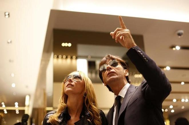 The former CEO of Gucci, Patrizio Di Marco, with his wife Frida Giannini. © Reuters