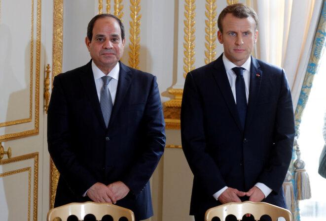 Abdel Fattah al-Sissi et Emmanuel Macron lors de la visite du premier à Paris en octobre 2017. © Reuters