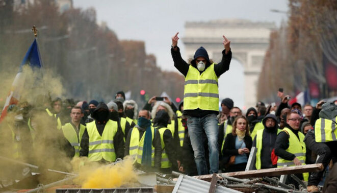 Yellow vest protestors on the Champs-Élysées avenue in Paris, November 2018. © Reuters