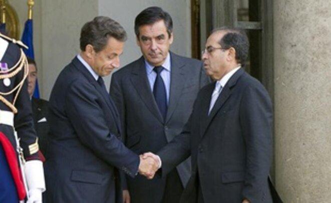 Mahmoud Jibril, Nicolas Sarkozy et François Fillon à l'issue de leur rencontre le 14 mai 2011 à l'Elysée — BERTRAND LANGLOIS/AFP