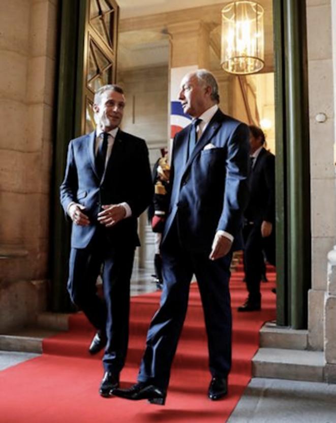 Emmanuel Macron with Laurent Fabius, president of the Constitutional Council. © Reuters