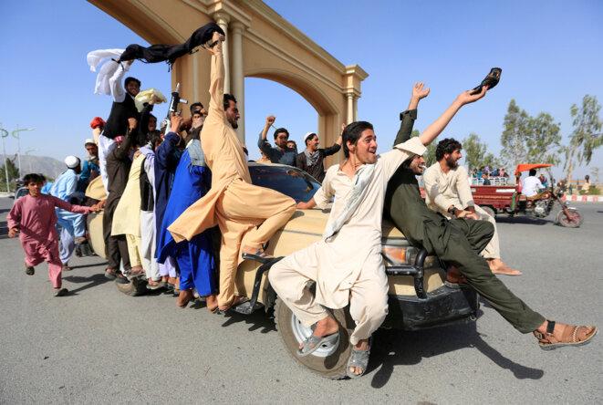 La liesse des Afghans lors d'un bref cessez-le-feu en juin 2018 à l'occasion de la fête de l'Aïd. © Reuters