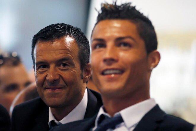 Cristiano Ronaldo (à droite) et son agent Jorge Mendes. © Reuters