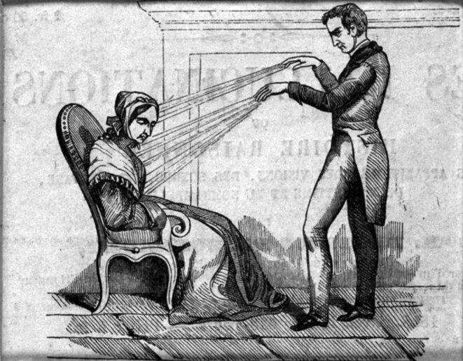 Un mesmeriste qui utilise du magnétisme animal sur une femme assise. Gravure sur bois