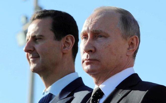 Bachar al-Assad et Vladimir Poutine, dans la région de Lattaquié en Syrie, le 11 décembre 2017. © Reuters