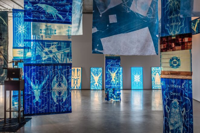 Edgar Cleijne and Ellen Gallagher, Installation view Highway Gothic, 2017 (detail), Bonniers Konsthall.  16mm film installation with 70mm film and canvas cyanotype banners © Ellen Gallagher & Edgar Clejine, courtesy Hauser & Wirth & Gagosian Galley