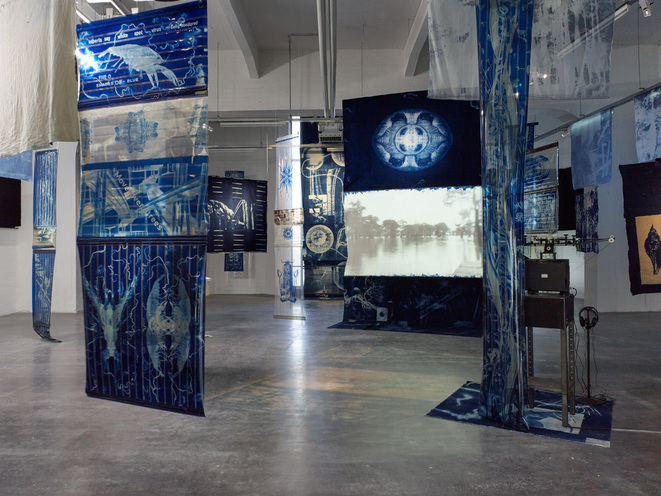 Edgar Cleijne and Ellen Gallagher, Installation view Highway Gothic, 2017 (detail), 16mm film installation with 70mm film and canvas cyanotype banners © Courtesy of the artists