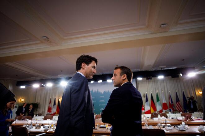 Justin Trudeau et Emmanuel Macron le 9 juin 2018 au G7 de Charlevoix (Québec). © Reuters
