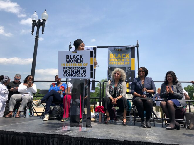 The April 30th rally in Washington, DC in support of Ilhan Omar. From third-left to right Alicia Garzia (Black Lives Matter), Nina Turner (ally of Bernie Sanders), Ilhan Omar (standing), Angela Davis, and Representatives Ayanna Pressley and Rashida Tlaib. © Mathieu Magnaudeix