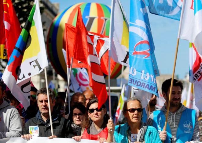 Unité syndicale dans les cortèges du 9 mai contre la réforme de la fonction publique. © Reuters