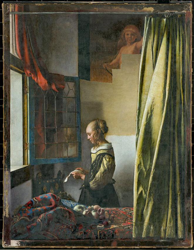 """""""La liseuse à la fenêtre"""" en cours de restauration."""