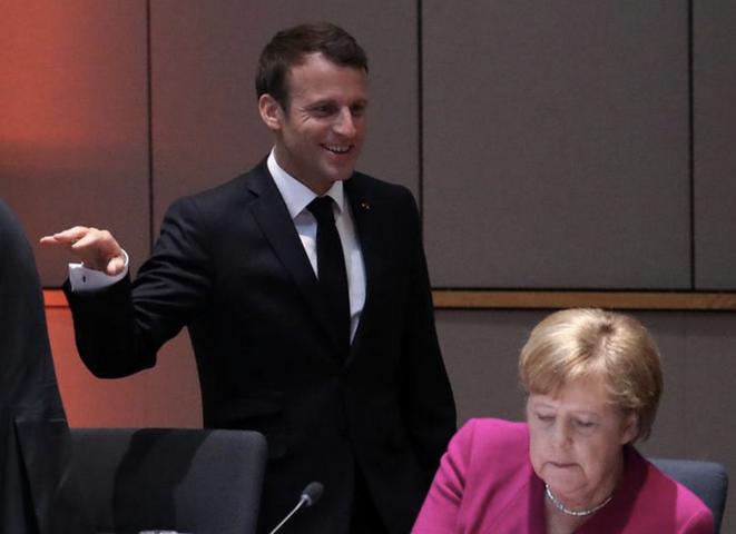 Emmanuel Macron et Angela Merkel à Bruxelles, le 28 mai. © Reuters