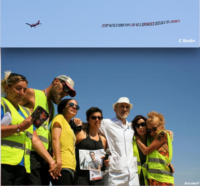 Banderole aérienne et collectif du 1er août © C Bodin et V Oulhen