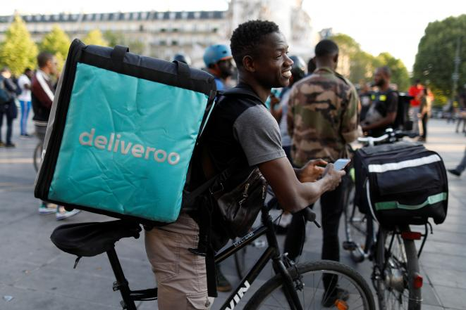 A Deliveroo courier at the protest in Place de la République in central Paris on August 7th 2019. © Reuters/Charles Platiau