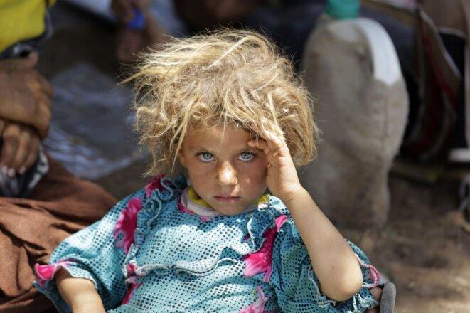 Une fillette de 6 ans, sur la route de l'exode en 2014. © Youssef Boudlal / Reuters