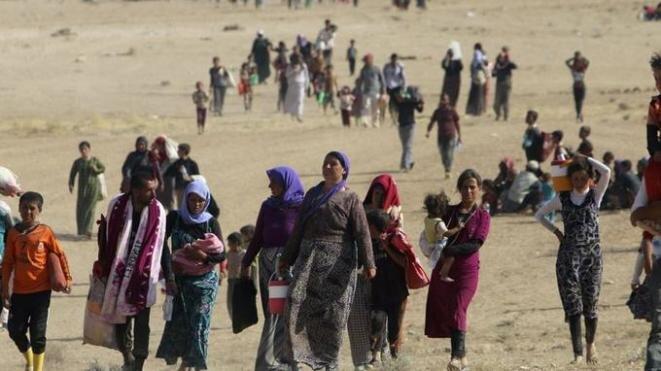 11 de agosto de 2014. Yazidíes huyen de la ciudad de Sinjar, en el noroeste de Iraq, en manos del Estado Islámico. © Reuters